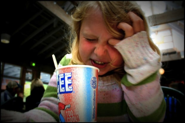 photo of girl and icee drink with brain freeze