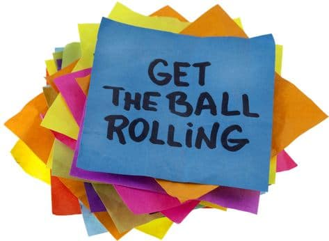 """photo of sticky notes with top one saying """"get the ball rolling"""""""